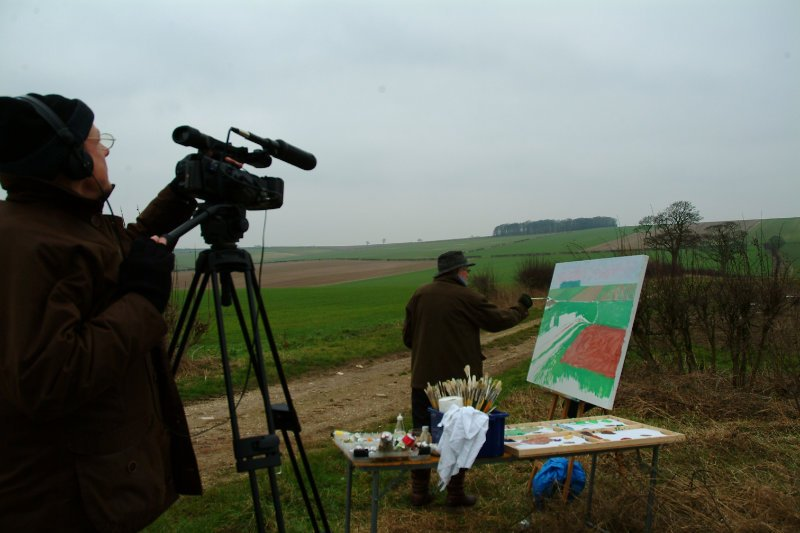 Director Bruno Wollheim filming David Hockney painting